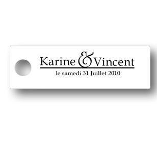 étiquette dragées mariage de couleur blanche forme rectangulaire avec le prénoms des futur mariés